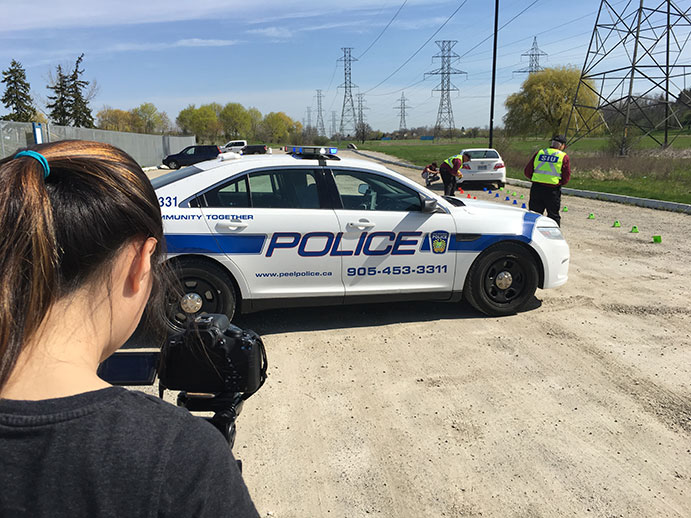 This image shows students from White Oaks Secondary School setting up for a video shoot as part of the SIU's video series that set out to provide informative answers to frequently asked questions about the Unit.