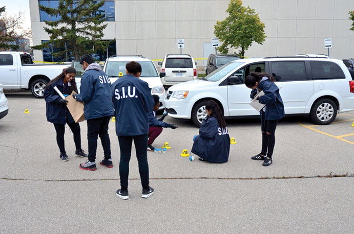 This is a photo of students collecting evidence at the scene.