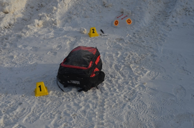 The abandoned knapsack and knife are seen at the base of the snowbank at the back of the photo, just right of centre.