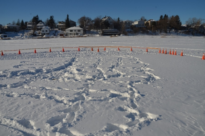A large number of footprints were visible in the snow.  A key fob, reddish staining (believed to be blood), and fabric, were visible in an area between the footpath and the lake's edge. These areas were protected with pylon coverings.