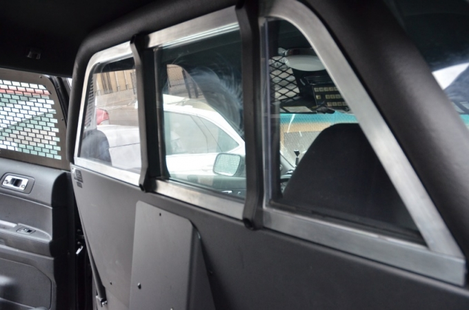 The Complainant was arrested and placed into the rear seat of an NRPS vehicle, a Ford Explorer SUV. The SUV was equipped with a Plexiglas security partition located between the front and back seats of the vehicle.