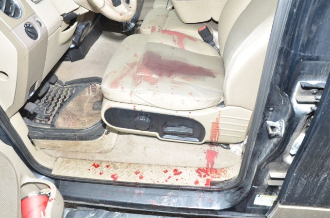 The blood-stained interior of the Complainant's motor vehicle.