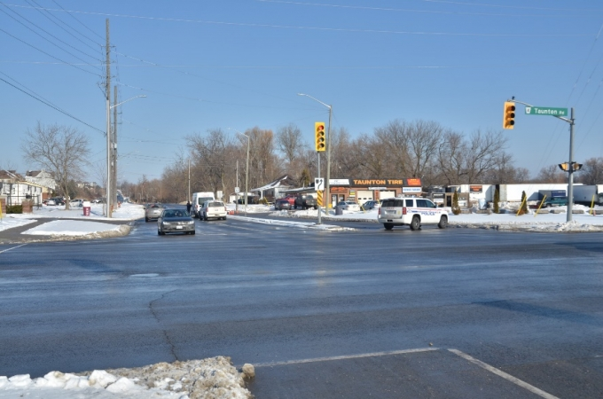 The intersection of Taunton Road and Townline Road, approaching the collision scene.  The photo depicts the road and weather conditions on the date of the collision, but hours later, during daylight.