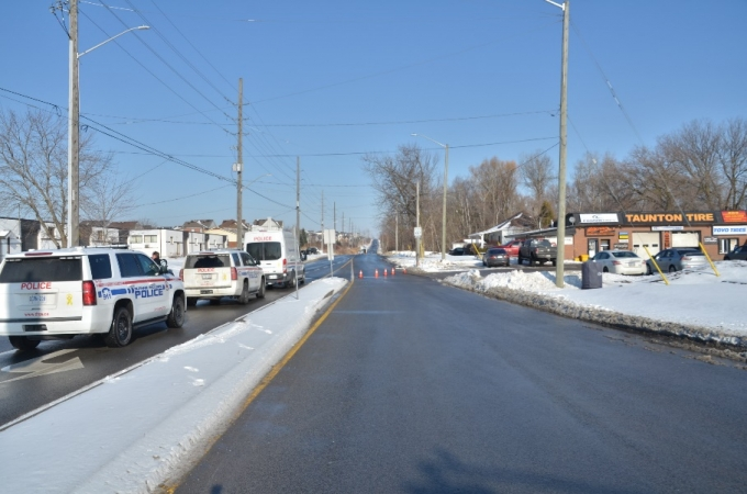 The camera angle is directed northbound on Townline Road, to where the collision occurred on the right side of the road, past the orange cones seen on the roadway.