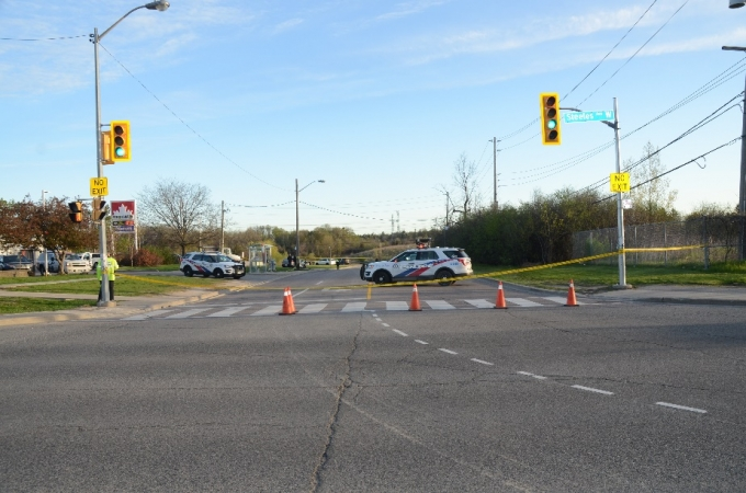 The Collision scene is located in the centre of the photo, just past the two parked police cruisers.