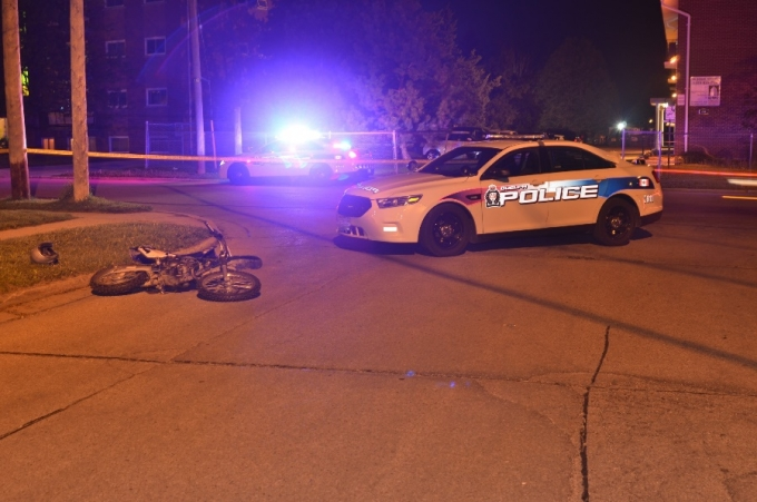The crashed motorcycle and the police vehicle involved in the pursuit.