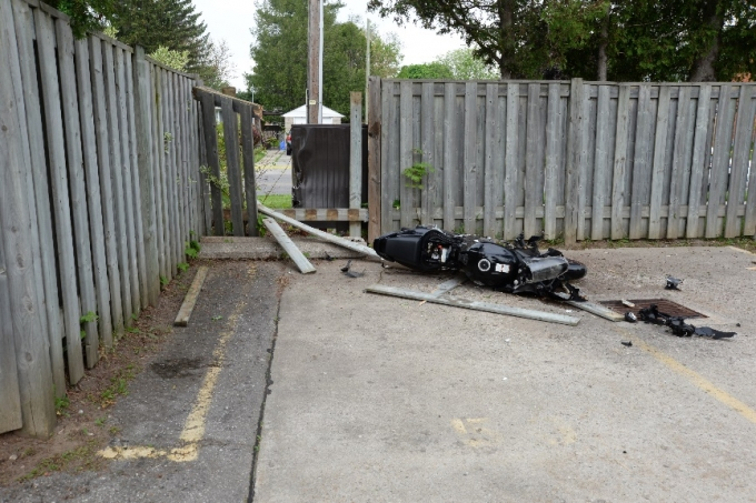 The motorcycle when it came to rest after crashing through the fence into the church parking lot.