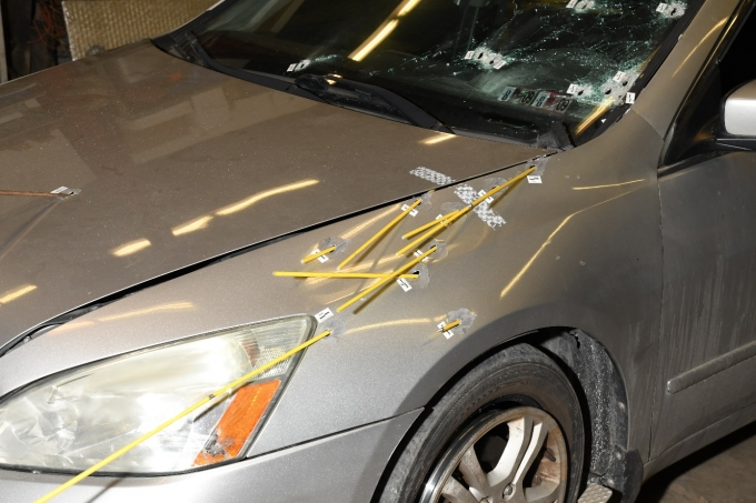 Exterior trajectory examination of the Complainant's Honda Accord, depicting the paths of the bullets which hit the vehicle.