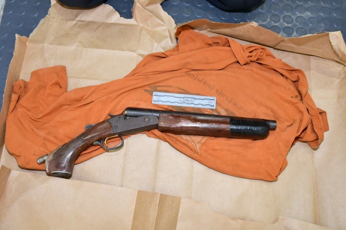 The altered twelve-gauge Remington model single shot shotgun which was found in the Complainant's backpack.