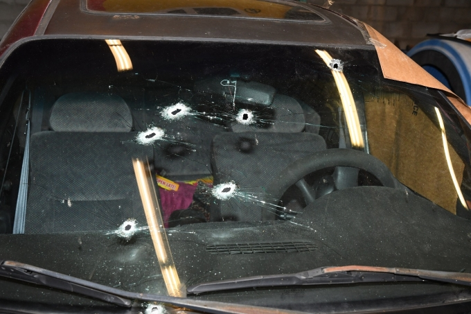 Figure 2 - The bullet holes in the windshield of the Complainant's Neon.