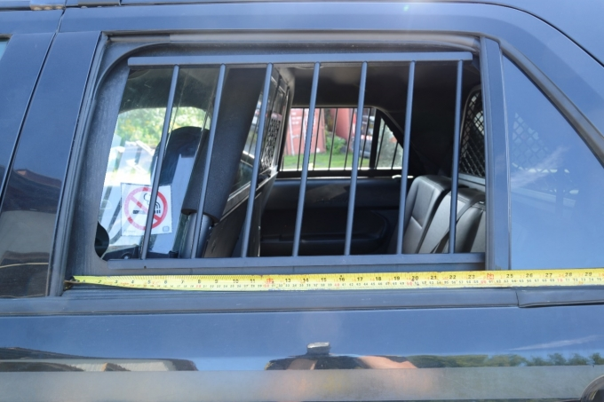 Figure 2 - A close-up of the bars on the back window with a measuring tape showing their spacing.