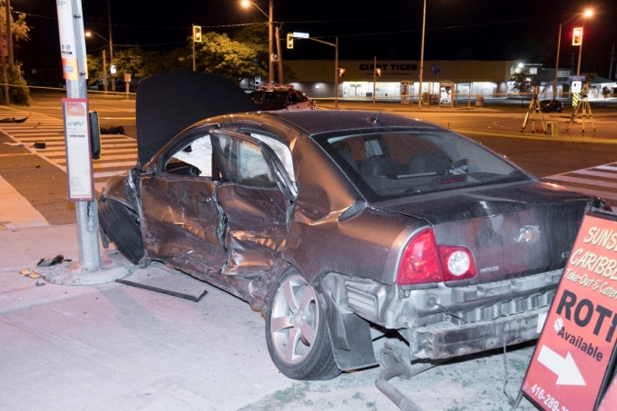 Figure 2 - The Chevrolet Malibu with extensive damage to its driver's side.