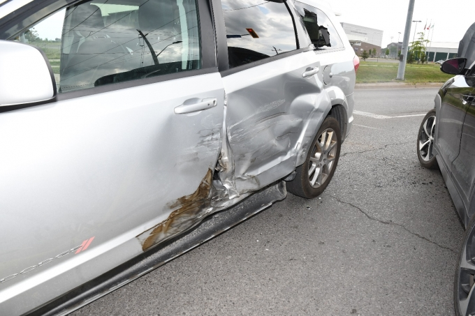 Figure 3 - The Dodge Caravan with damage to its driver's side.