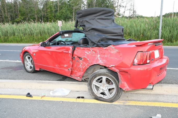 Figure 1 - The red Mustang Complainant #1 was driving and the replica Crossman air gun that was located near the vehicle.